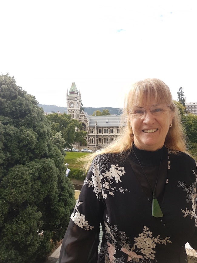 Photo of Dr Jillian Evans outside the University of Otago clocktower.