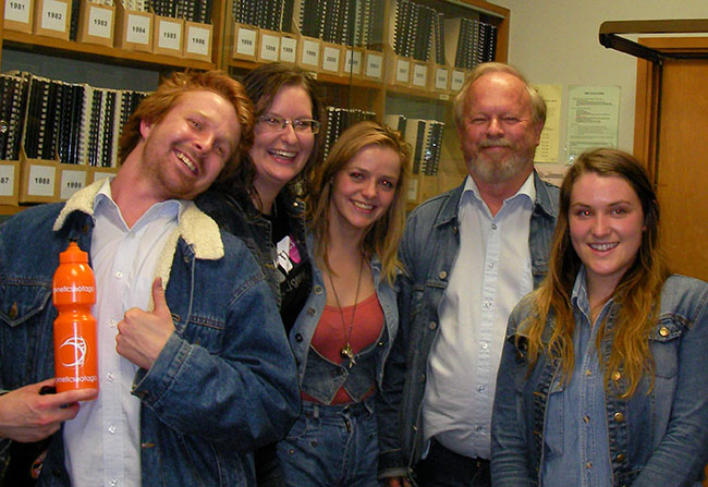 students wearing double denim with Russell Poulter