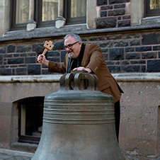 Jim Wilkes donging the bell marking the submission of his DBA 1x