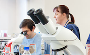 People working with microscopes thumbnail