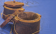 Pacific wooden pots on blue cloth thumb