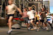 Photo of a group of runners passing the University of Otago Registry building