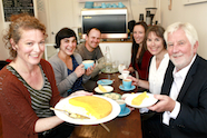 Photo of Keely McGlynn and guests at her cafe which promotes health portions of food.