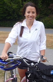 Photo of Amy McColl standing with her bicycle