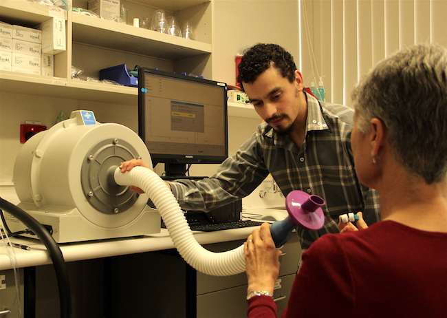 Patient with a spirometer.