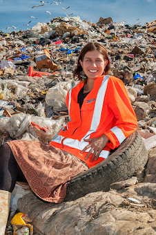 Miranda Mirosa sitting on landfill image