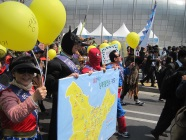 children holding balloons in climate action march in Seoul