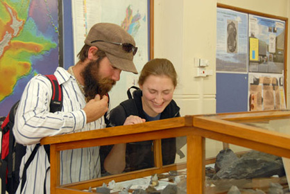 students in the geology museum looking at displays