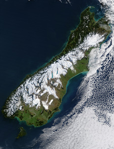 The Alpine Fault is the dominant structure defining the Australian-Pacific plate boundary in the South Island of New Zealand. It runs as a single structure for over 500 km. It forms the sharp line separating the snow-covered Southern Alps in the east from the low coastal plain bordering the Tasman Sea in the west.