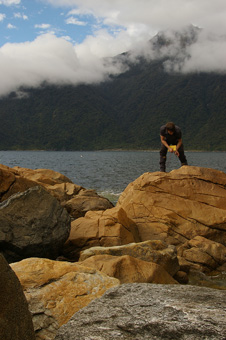 Tom Czertowicz looks at dunite in the Anita Ultramafics in Fiordland National Park