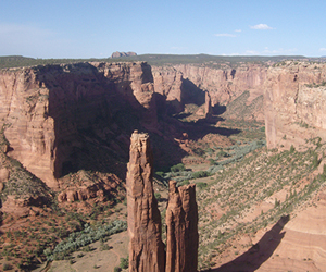 Spider Rock in Canyon de Chelly National Monument, Northern Arizona, carved by Monument Creek eroding into Permian aeolian sandstone.