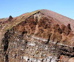 The colourful volcanic rocks and soils in the crater of Mt Vesuvius, Italy.