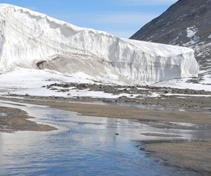 Not-so-Dry Valleys:  At the height of Antarctic summer, Commonwealth Stream drains the Commonwealth Glacier, Taylor Valley, Antarctica