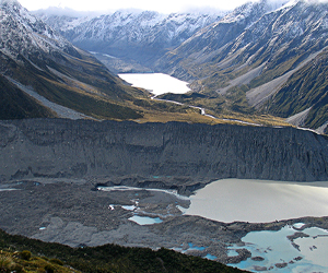 Southern Alps glacial landscape with moraines and terminal lakes of the Mueller Glacier (foreground) and the Hooker Glacier in the distance.