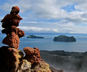 Heimaey Island, South of Iceland. The rocks in the foreground are from this recent eruption, while volcanic islands in the background were formed millions of years ago.