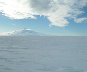 The vast emptiness of the Ross Ice shelf is interrupted by Mt. Terror on the horizon. Ross Ice Shelf, Antarctica.