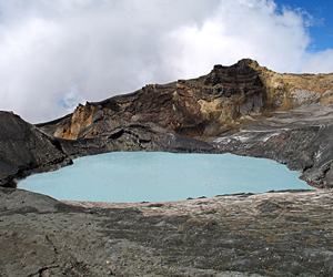 Mount Ruapehu's steaming Crater Lake surrounded by andesitic lava and tephra. The collapse of the lake rim has generated devastating lahars in the past.