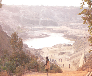 Artisanal miners re-working an abandoned open pit Cu/Co mine in the Democratic Republic of Congo