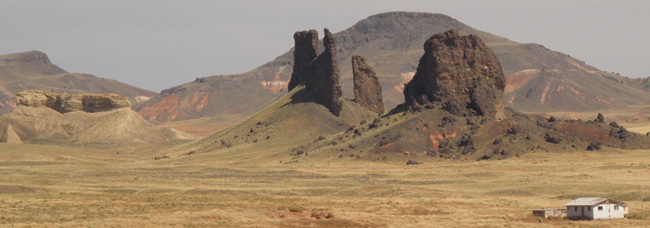 Roots of a volcanic complex in Hopi Buttes, USA, stand proud above the arid landscape of the Navajo Nation.
