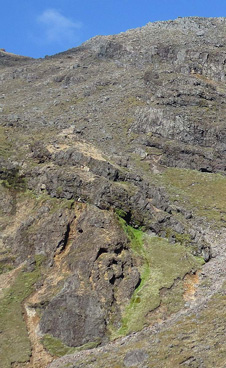 Tabular lavas above knobs of complexly jointed andesite possibly intruded into wet clastic debris, Tongariro volcano.