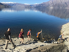 Postdoctoral Fellow Matt Tarling and undergraduate students traversing Haast Schist on the shores of Lake Hawea