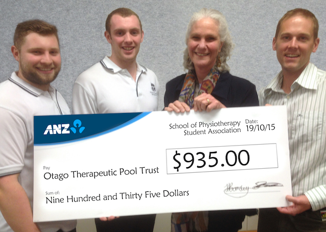 Physiotherapy students and Professor Leigh Hale with a cheque for the Otago Therapeutic Pool Trust