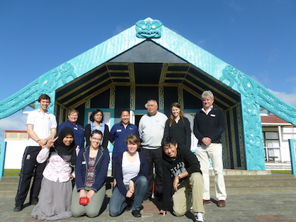 A group of people gathered in front of Noho Marae.