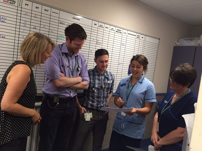 Medical staff discussing patient notes