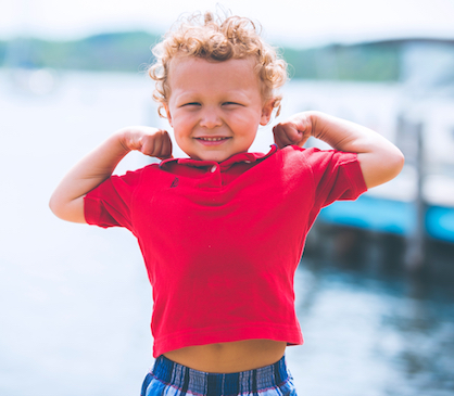 Child flexing muscles