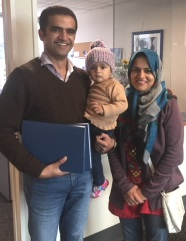 Yasir and family with bound thesis webphoto