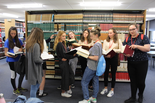 10 students reading law in the library