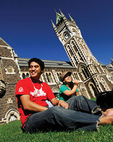 student sitting in front of clocktower