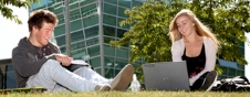 Two MBA students studying outside on campus