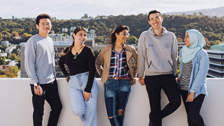 A group of five international students on a balcony at University College, Dunedin Campus