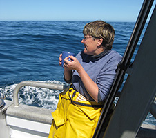 Abby Smith having a cup of tea on a boat out at sea image 1x