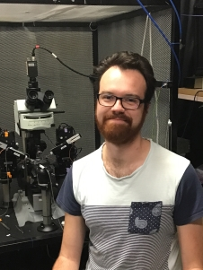 Bradley Jamieson in front of microscope 2019