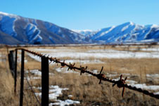 Barbed wire in foreground of Mackenzie Basin
