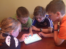 kids working on a tablet image