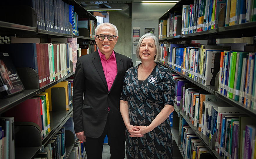 Professor Michael Baker and Dr Amanda Kvalsvig in library image 2021
