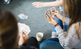 University of Otago students playing a card game. Image.
