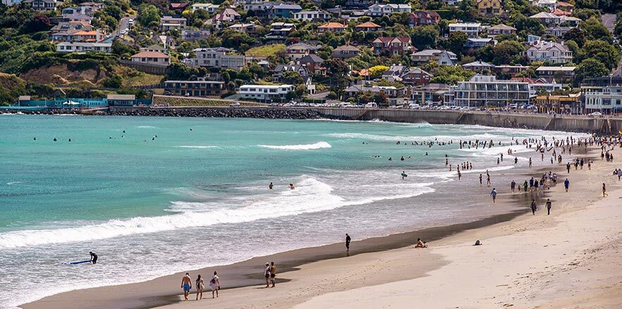 People swimming and surfing at Saint Clair Beach in Dunedin. Photo credit: Dunedin NZ.