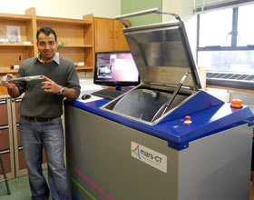 Centre for Bioengineering post-doctoral fellow Raj Panta with the MARS scanner and a sample of atherosclerotic plaque.