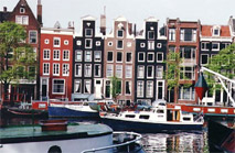 A photo of houses and a canal in Amsterdam.