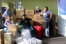 PIRSSU folk with donations for Samoa image