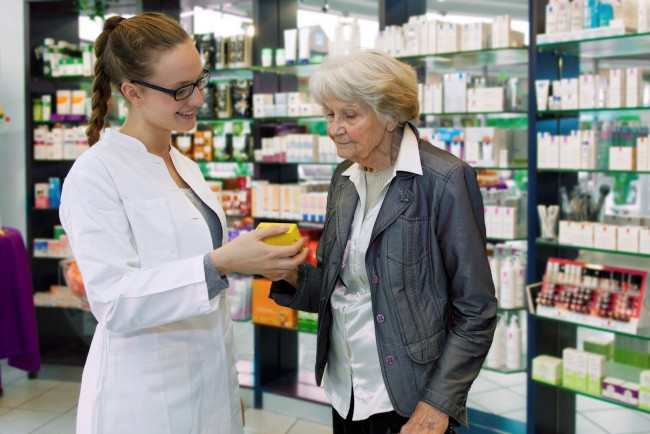 Pharmacist and a member of the public at an Understand Your Medicines clinic