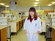 Eunice Tan standing in lab Thumbnail