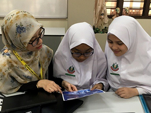 Nadiah showing students brochuresb 232px