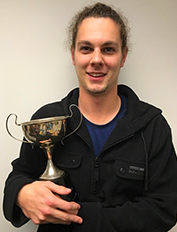 physio_cory glover from PSA holds trophy 2017