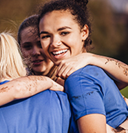 physio_thumbnail young women group hug 2017 Sports 648944056