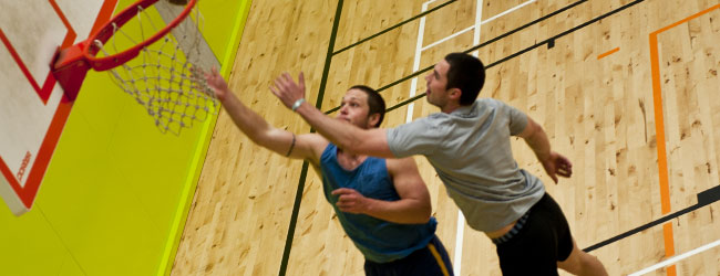 Photo of students playing basketball at Unipol